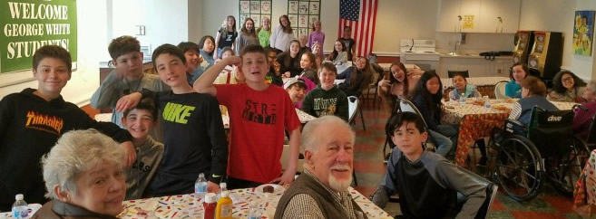 GW 6th grade enjoying a luncheon at the Atrium Living facility
